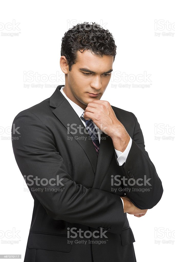 Thoughtful young business man stock photo