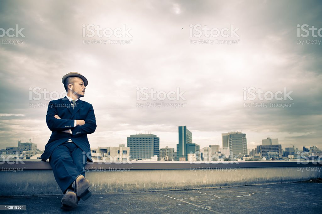 Thoughtful young Japanese businessman overlooking the Tokyo Financial District royalty-free stock photo
