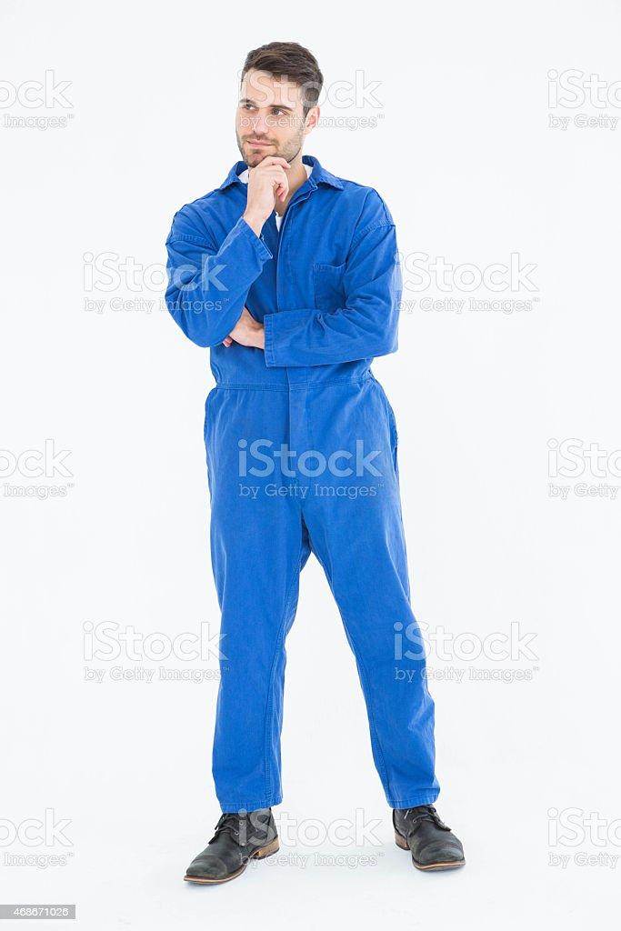 Thoughtful young male mechanic stock photo