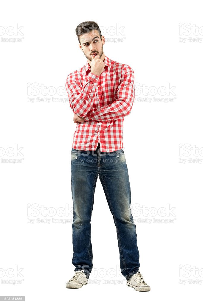 Thoughtful young man having a dilemma stock photo