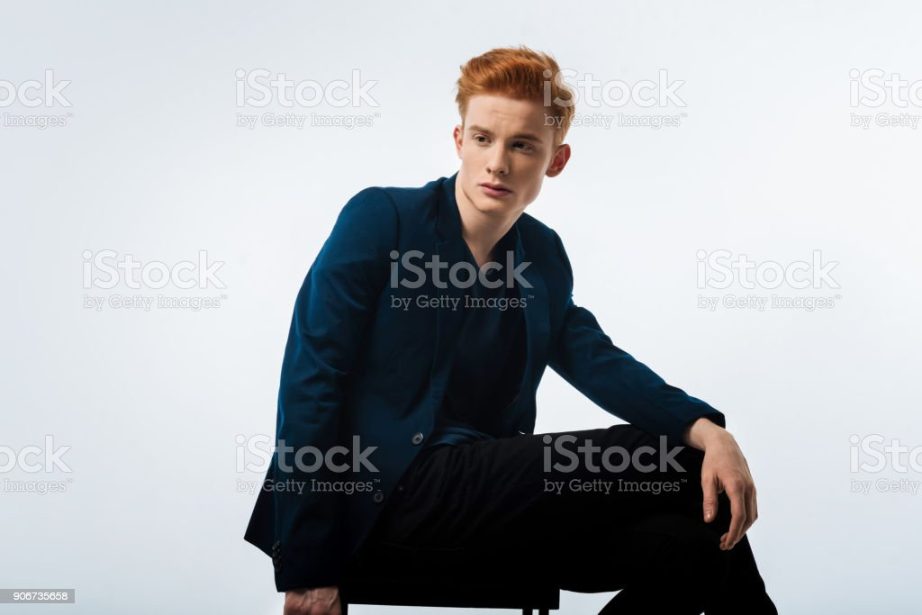 Thoughtful young man wearing a jacket stock photo