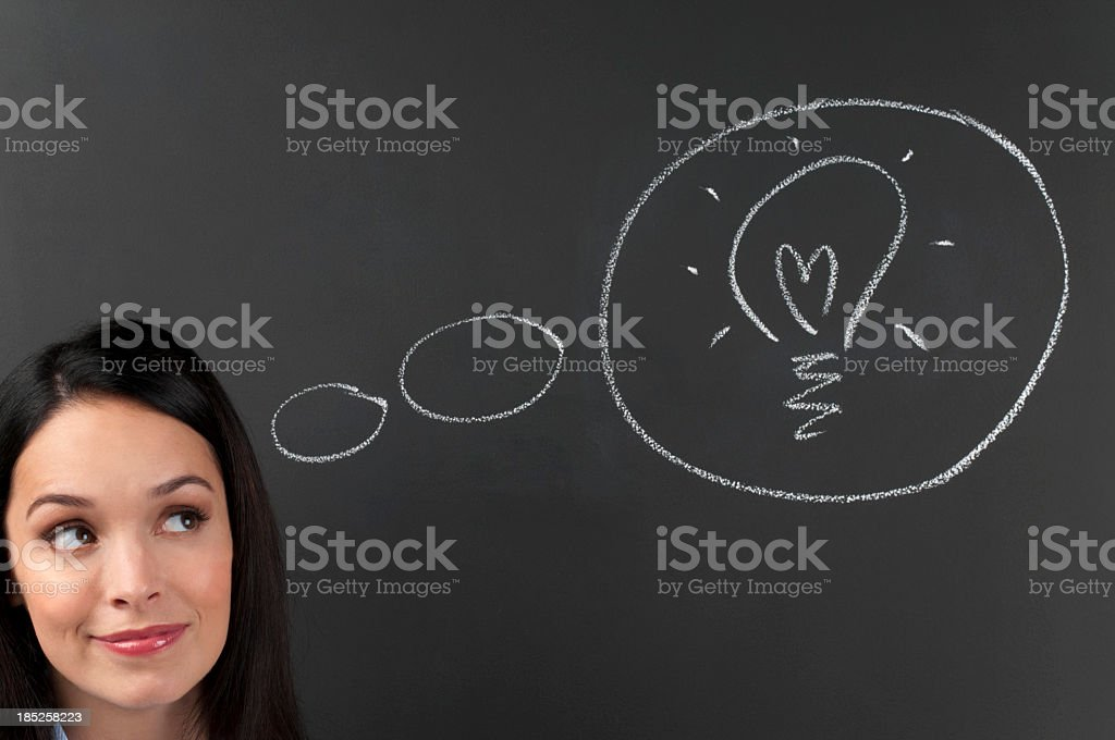 Thoughtful young Woman Thinking a big idea royalty-free stock photo