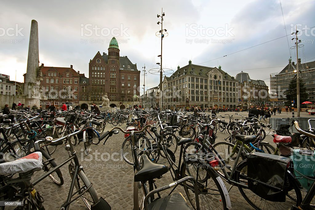 Thousands of bicycles on the Dam in Amsterdam Netherlands - Royalty-free Amsterdam Stock Photo