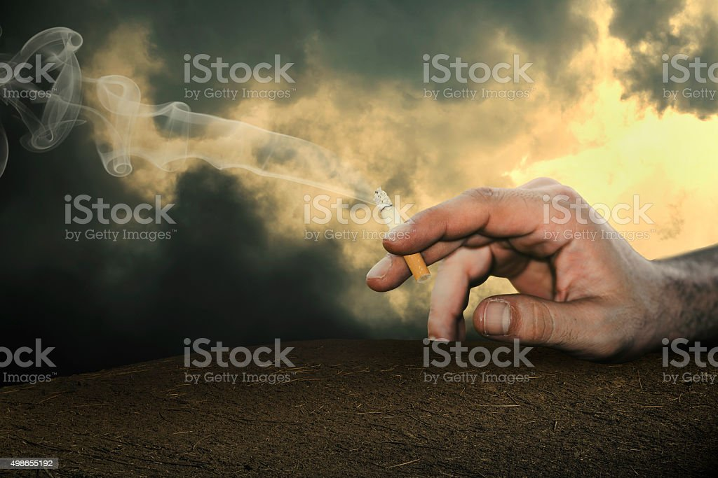 thr cigarette is in the hand of man. stock photo