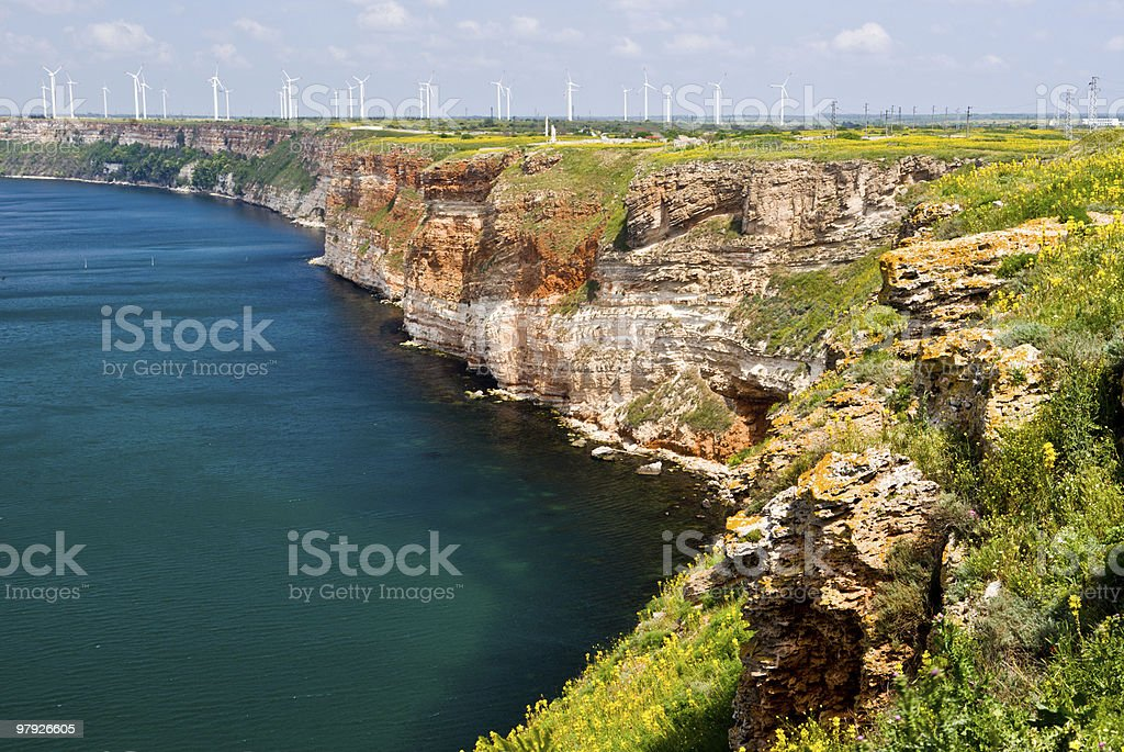 Thracian cliffs and Wind turbines royalty-free stock photo