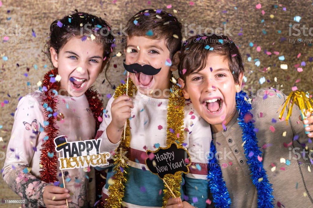 Thre happy kids celebrating new year eve at home Thre happy kids celebrating new year eve at home Child Stock Photo