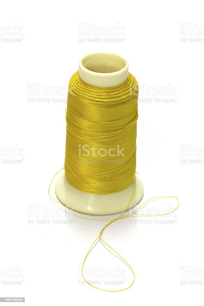 Thread bobbin isolated on white background royalty-free stock photo
