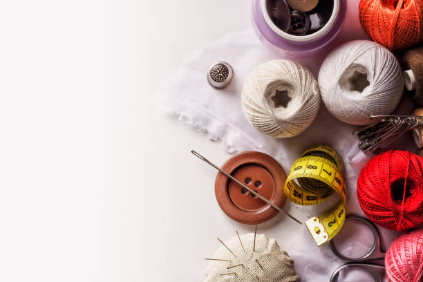 Thread buttons and other sewing items stock photo