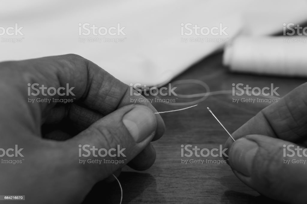 Thread into the needle royalty-free stock photo