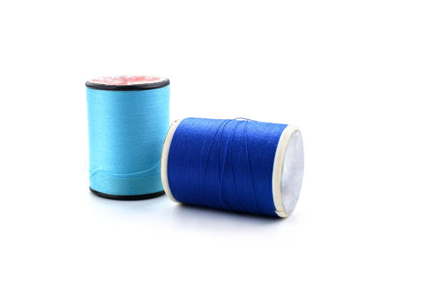 Thread isolated on white background Thread isolated on white background spool stock pictures, royalty-free photos & images