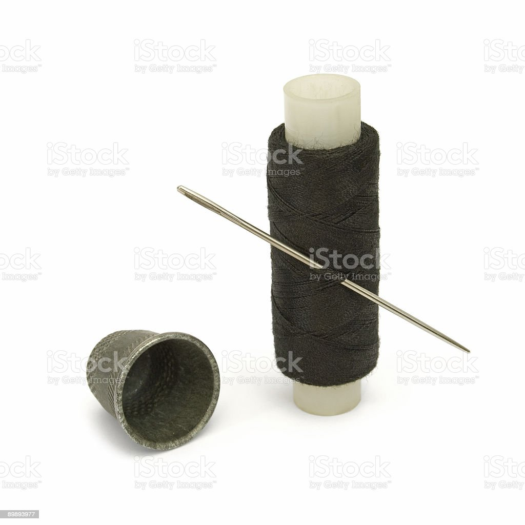 Thread, needle and thimble royalty-free stock photo