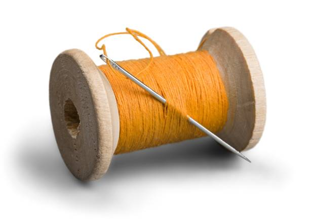 Thread. Spool of Thread and Needle sewing needle stock pictures, royalty-free photos & images