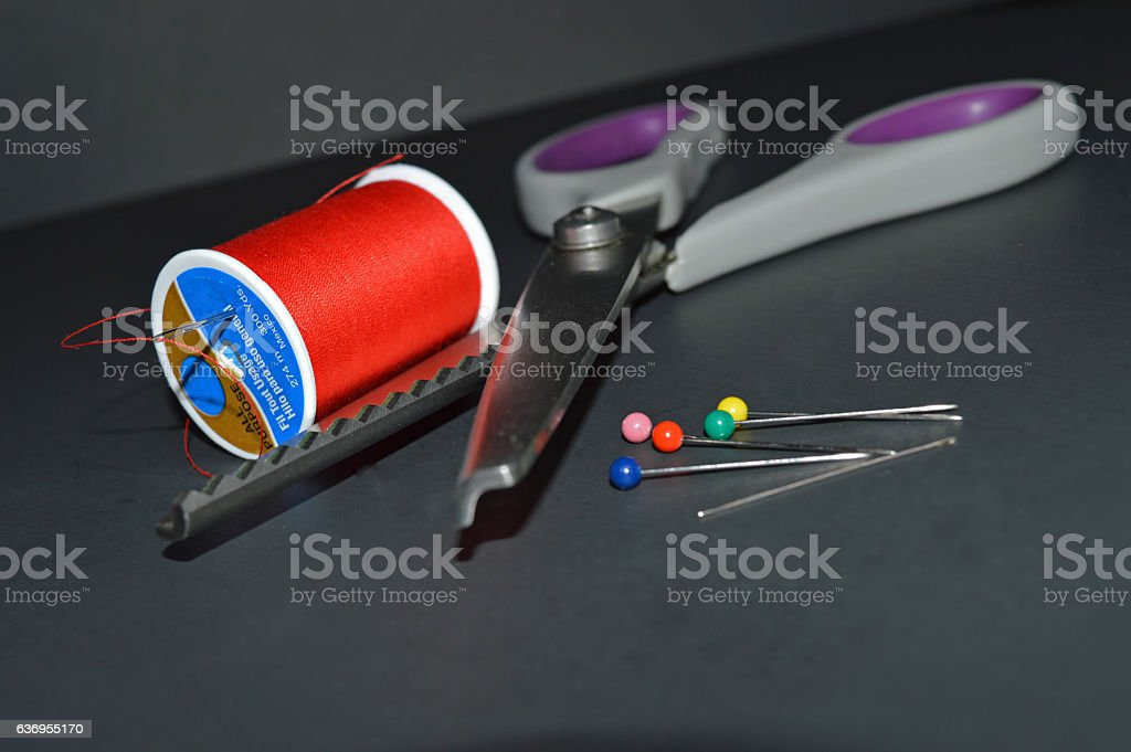 Thread, pins, and shears stock photo