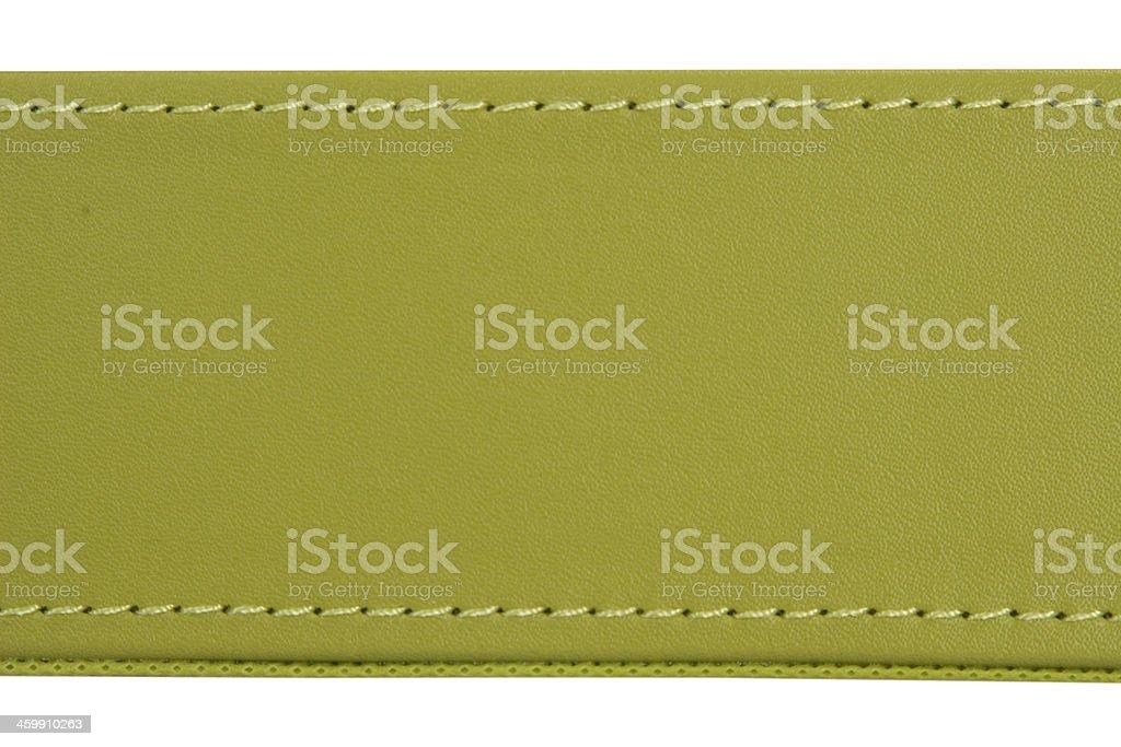 thread seam on green leather stock photo