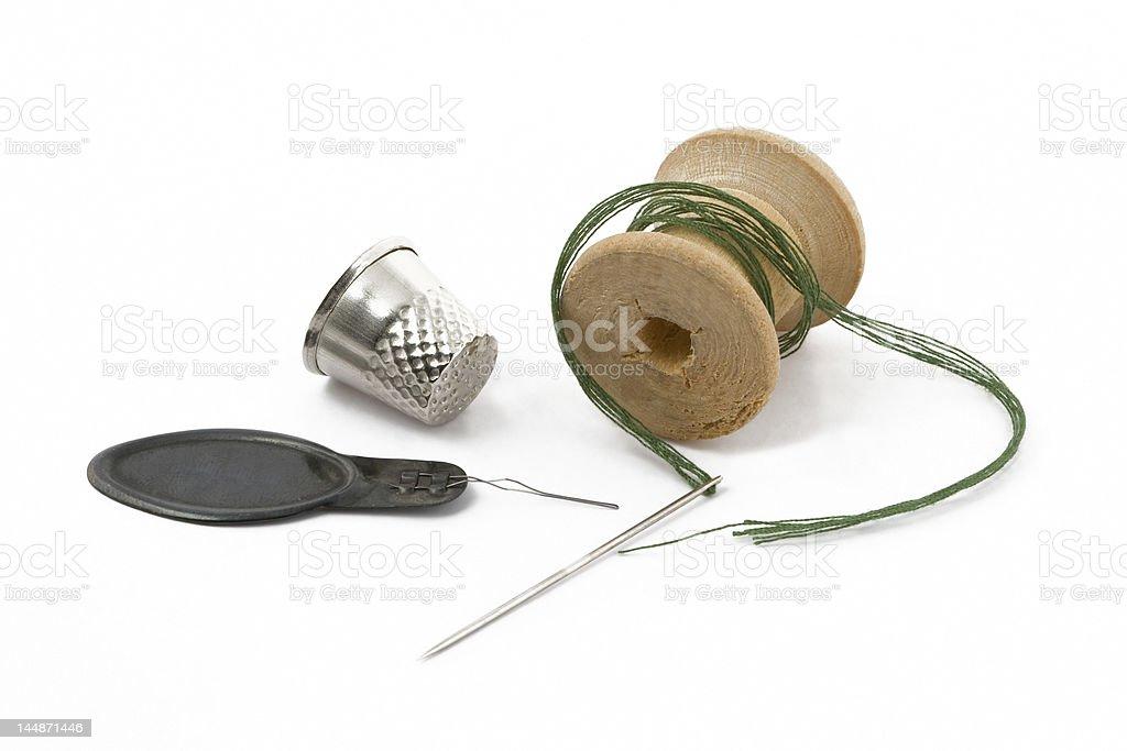 Thread, thimble and needle royalty-free stock photo