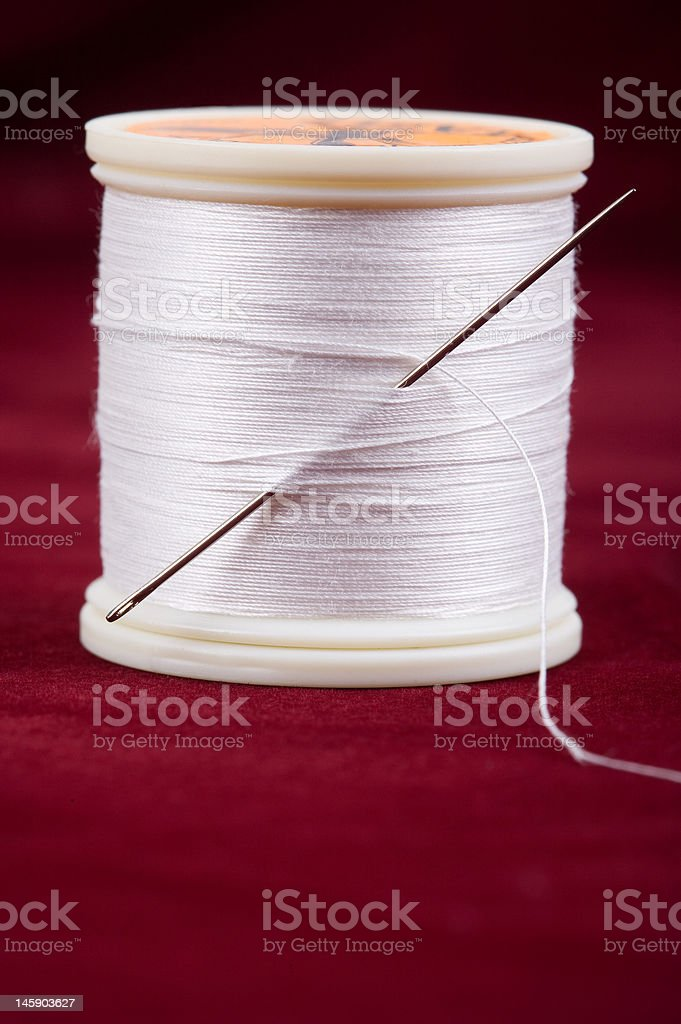 Thread with needle royalty-free stock photo