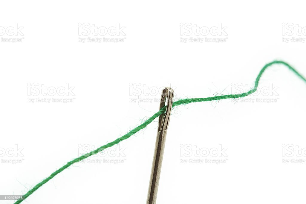 threaded needle on white royalty-free stock photo
