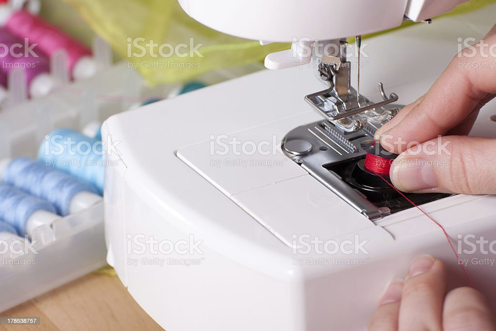 Threading a Needle in Sewing Machine royalty-free stock photo