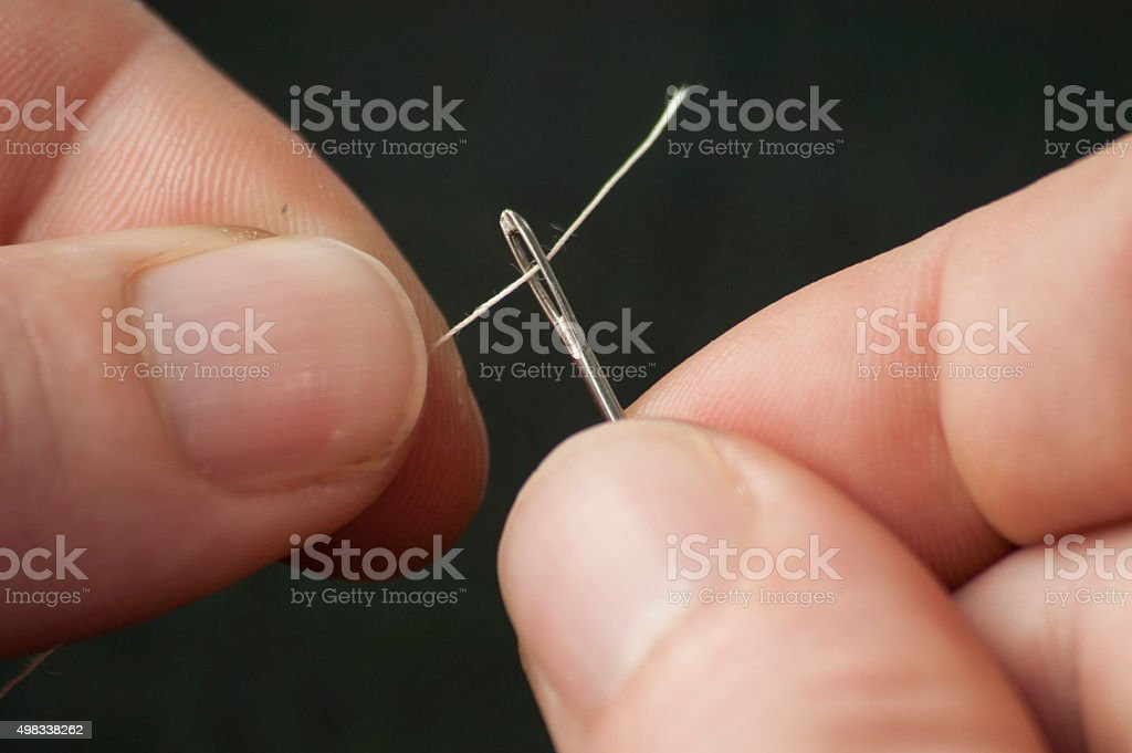 Threading a needle stock photo