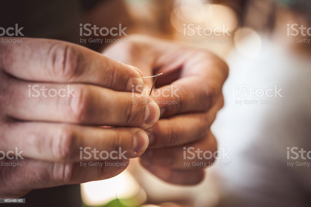 Threading  Embroidery Needle - Close Up Hands stock photo