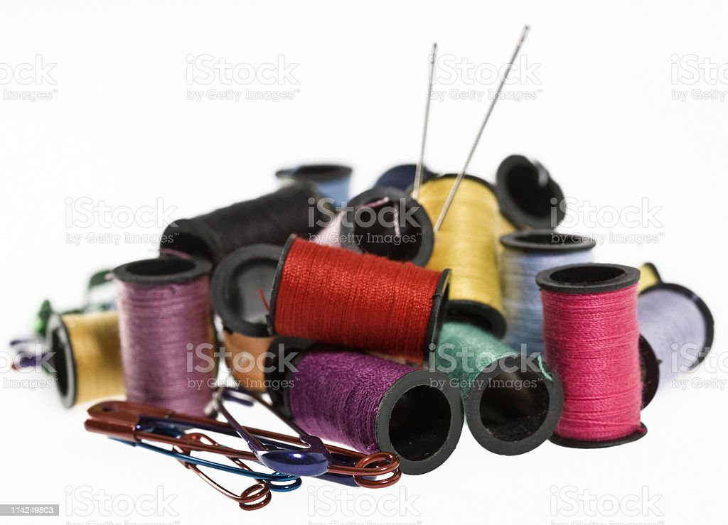 Threads, needles and safety pins stock photo