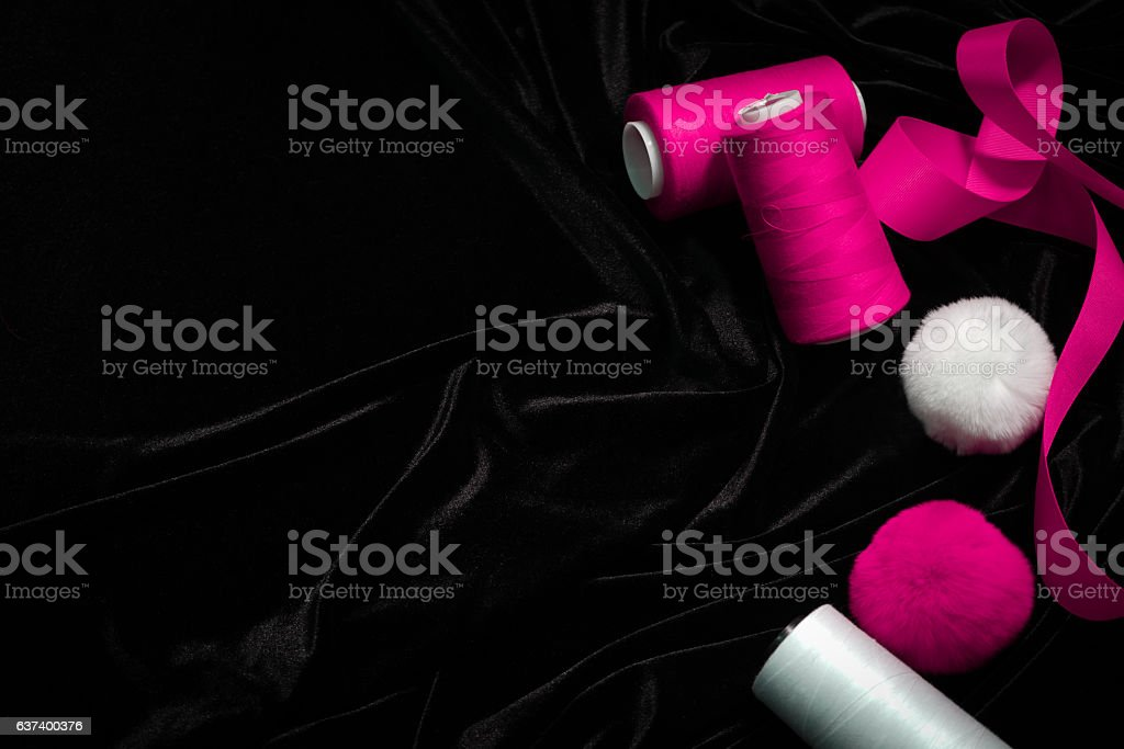 threads, ribbons on a black, pink, magenta, background stock photo