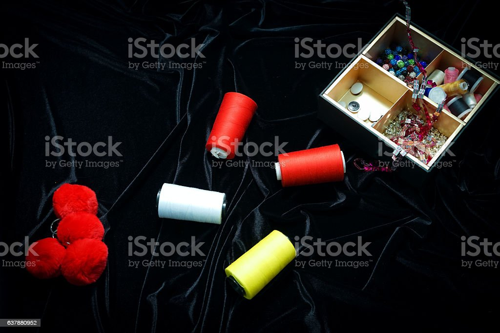 threads, ribbons on a black, red, background stock photo