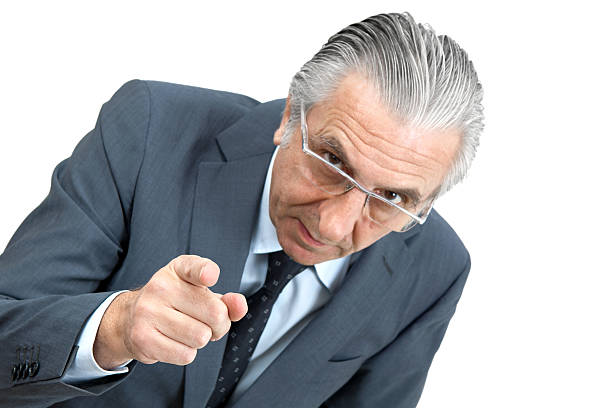 Threatening boss. Senior businessman pointing. cruel stock pictures, royalty-free photos & images