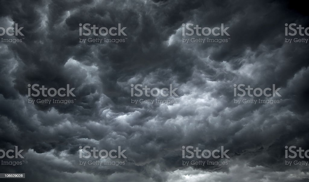 Threatening dark clouds covering the sky stock photo