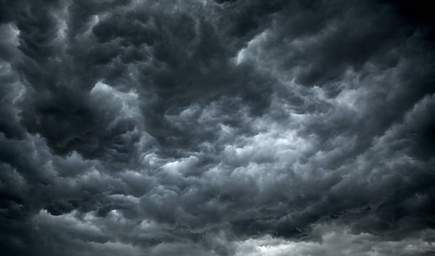 threatening dark clouds covering the sky - dramatic sky stock photos and pictures