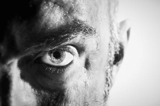 Threatening Man Glaring Angrily In Blackandwhite Closeup