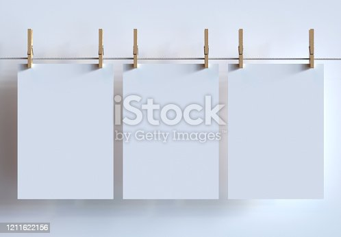 istock Three A4 Size Posters Mockup Hanging With Clothespins On Clothesline. 3d Render. 1211622156