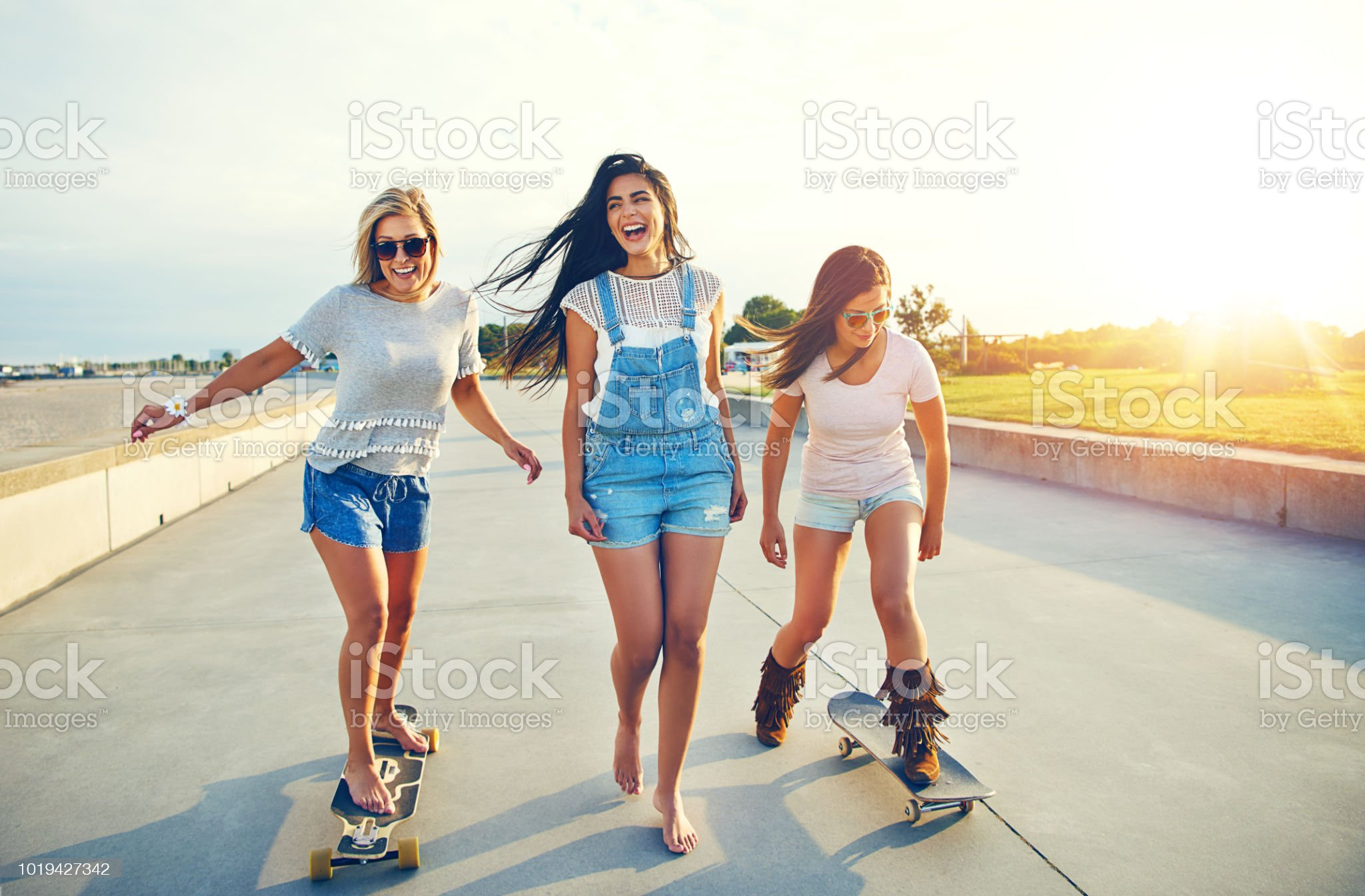 https://media.istockphoto.com/photos/three-active-young-woman-on-a-day-at-the-seaside-picture-id1019427342?s=2048x2048