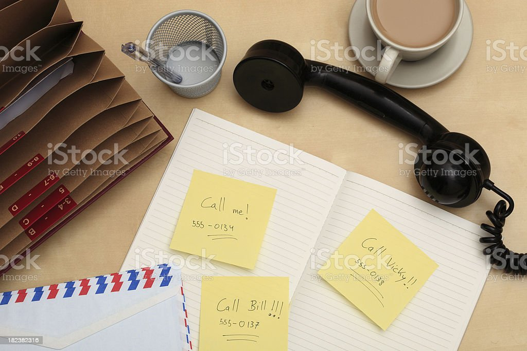 Three adhesive notes on a chaotic desk royalty-free stock photo