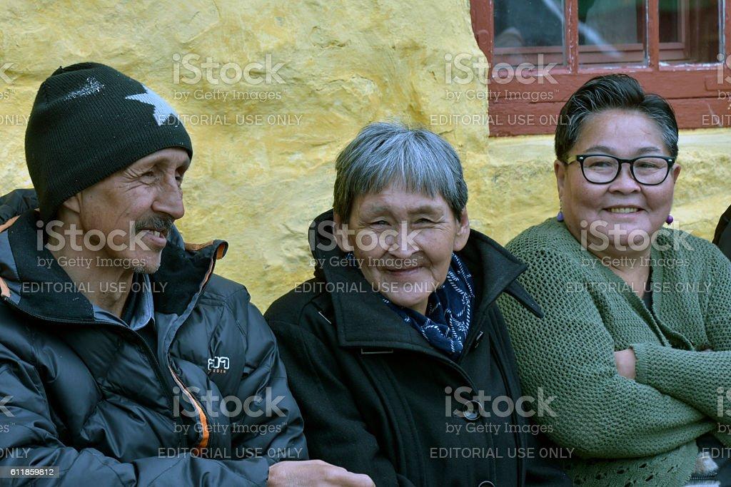 Three adult Greenlandic Inuit people stock photo