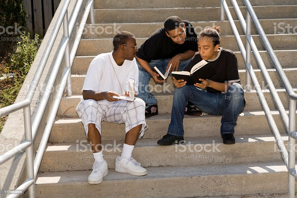 Three African American males studying on steps royalty-free stock photo