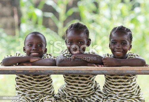 istock Three African Children at School Education Symbol Schoolgirl Schoolboy Sitting 492483466