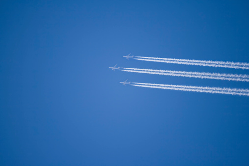 Three Airplains In A Blue Sky