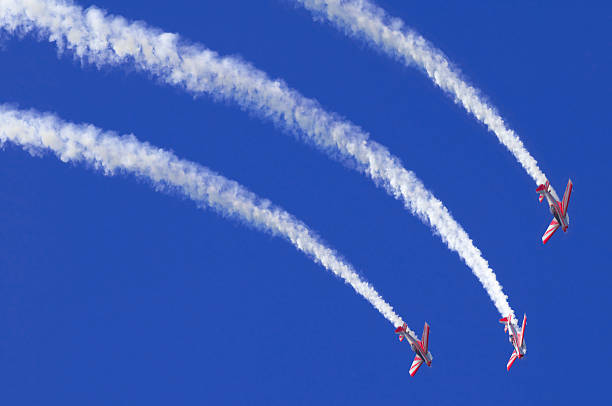 three airplanes during an airshow - airshow stock photos and pictures