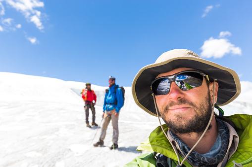 istock Three alpinists friends selfie walking climbing ice glacier mountain Andes Peru 897561414