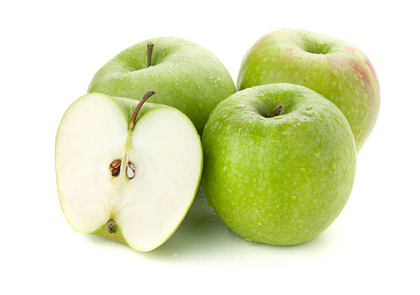 Three and half ripe apples Three ripe and half green apples. Isolated on white granny smith apple stock pictures, royalty-free photos & images