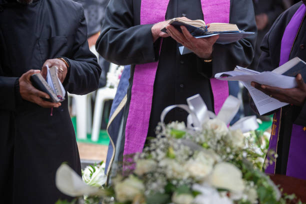 Three Anglican priests attending a funeral