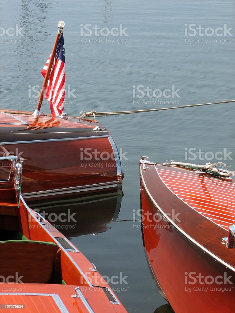 Three Antique Wood Boats Moored in Harbor stock photo