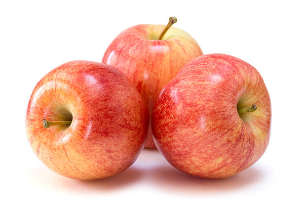 Three apples arranged in a bunch over a white background stock photo