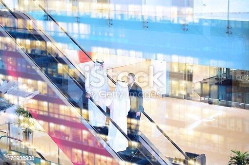 Three arab business men entering building