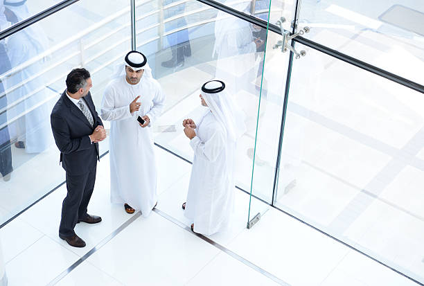 Three arab business men meeting Three arab business men meeting saudi arabia stock pictures, royalty-free photos & images