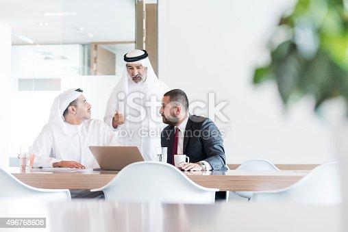 istock Three Arab businessmen in business meeting in modern office 496768608