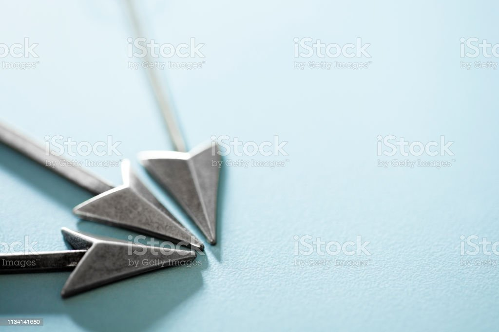 Three Arrows Converging At The Same Point stock photo