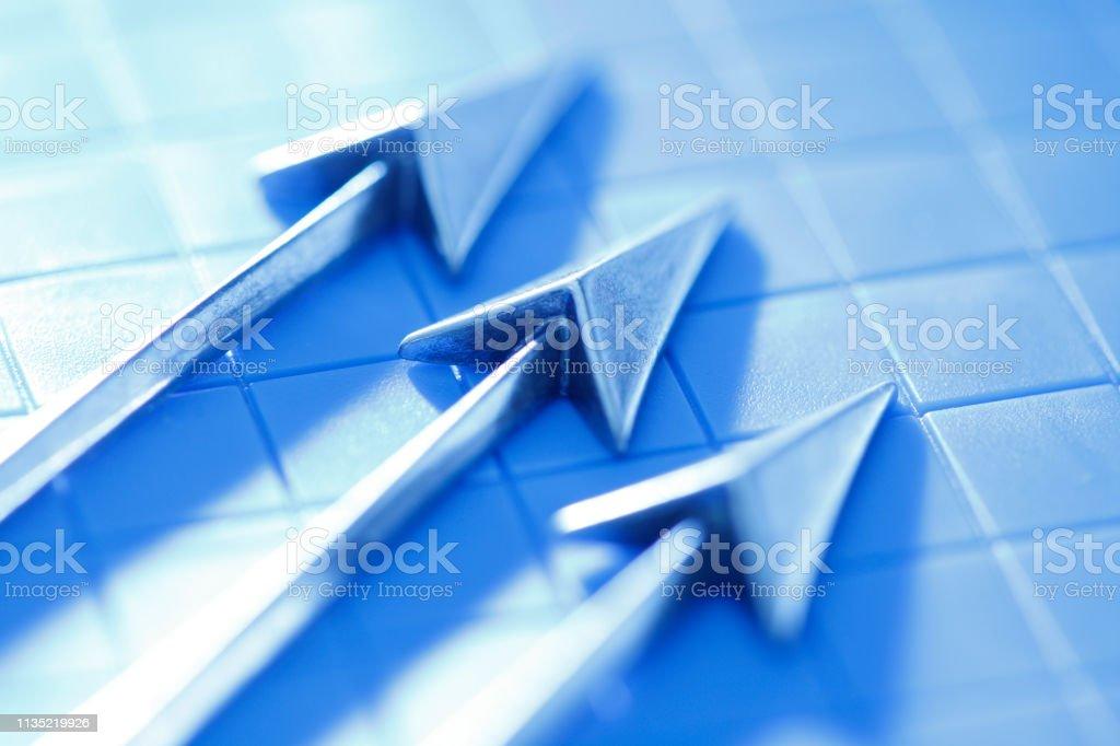 Three Arrows On A Grid stock photo