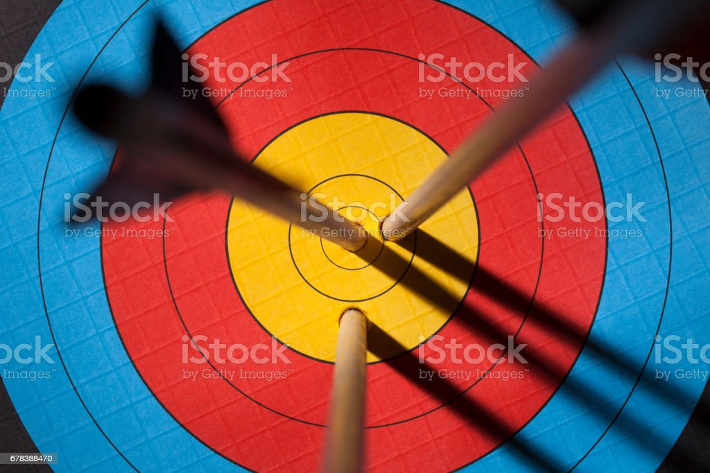 Three arrows on an archery target stock photo